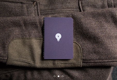 """Limited edition"" pocket notebook with a lightbulb on the cover, handsomely presented against a tweed jacket"